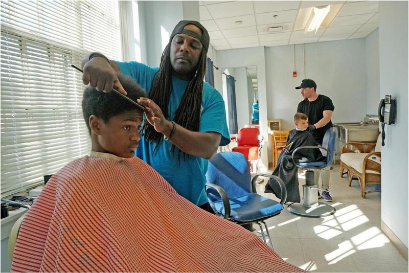 City, volunteer barbers help kids look sharp for first day of school Featured Photo
