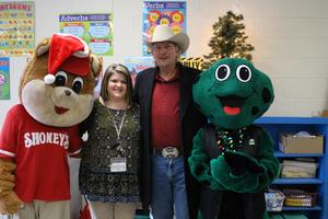 Picture of Ms. Shauna Wilson with Shoney Bear, WIVK Radio Personality Gunner, and WIVK the Frog.