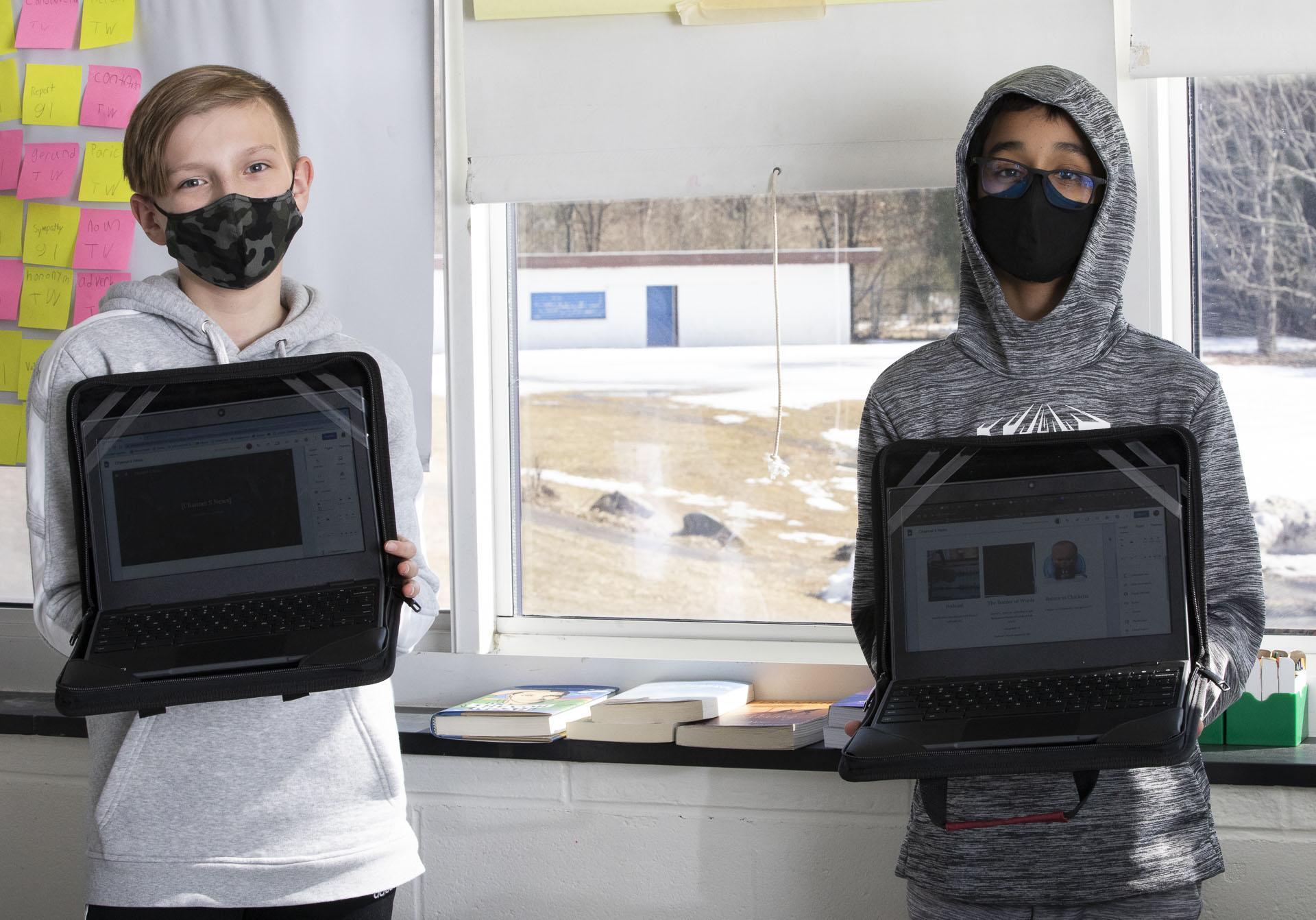 Boys watching laptops