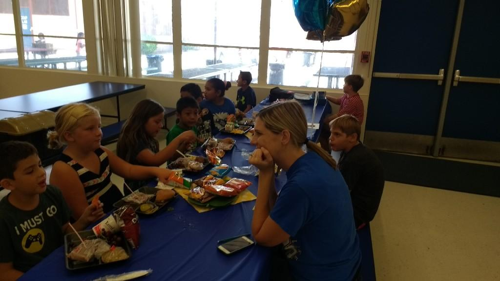 Mrs. Grant, AP having lunch with the third grade winners of Lunch with the Principal on August 25, 2017