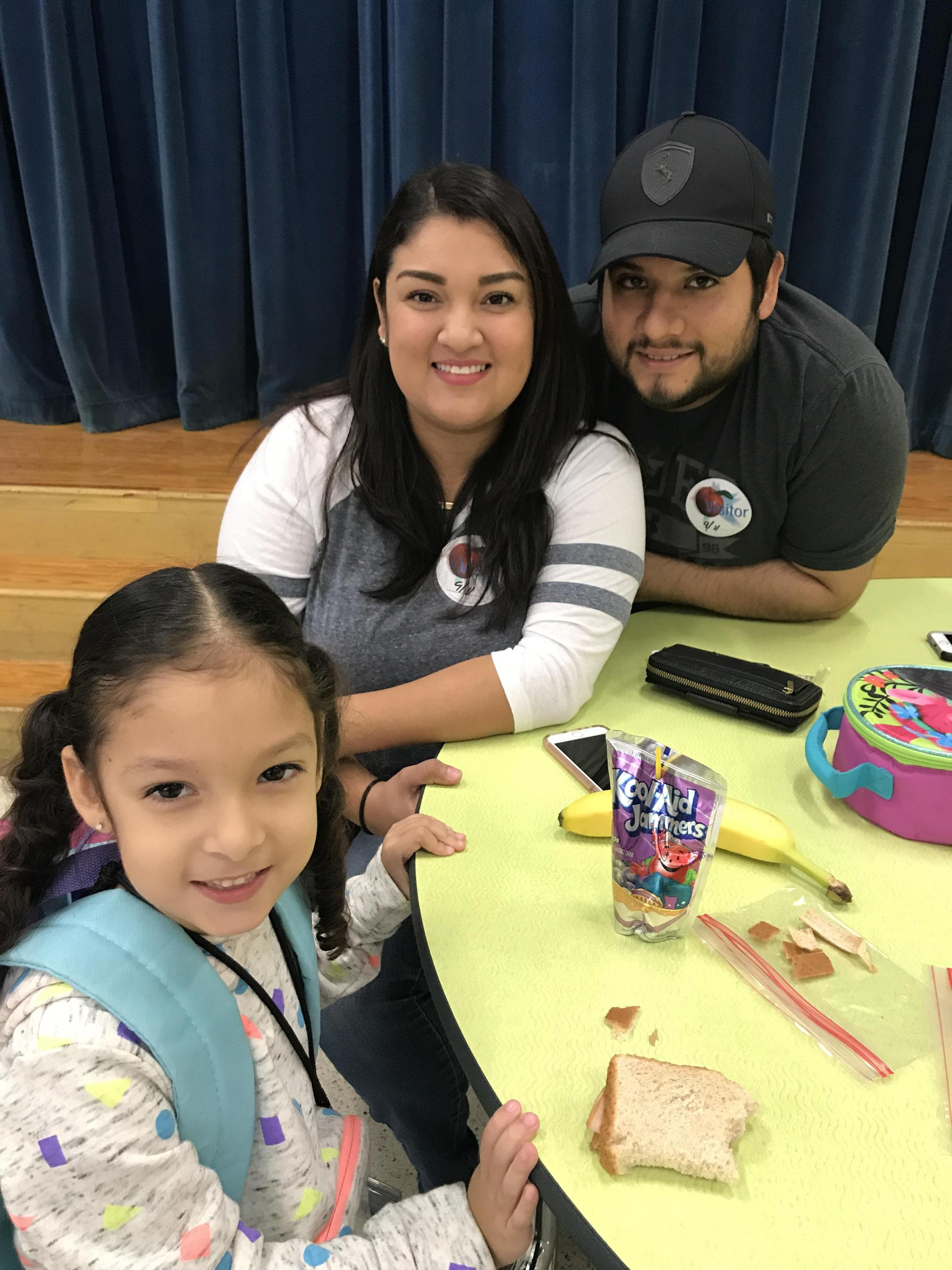 mom, dad and daughter having lunch together