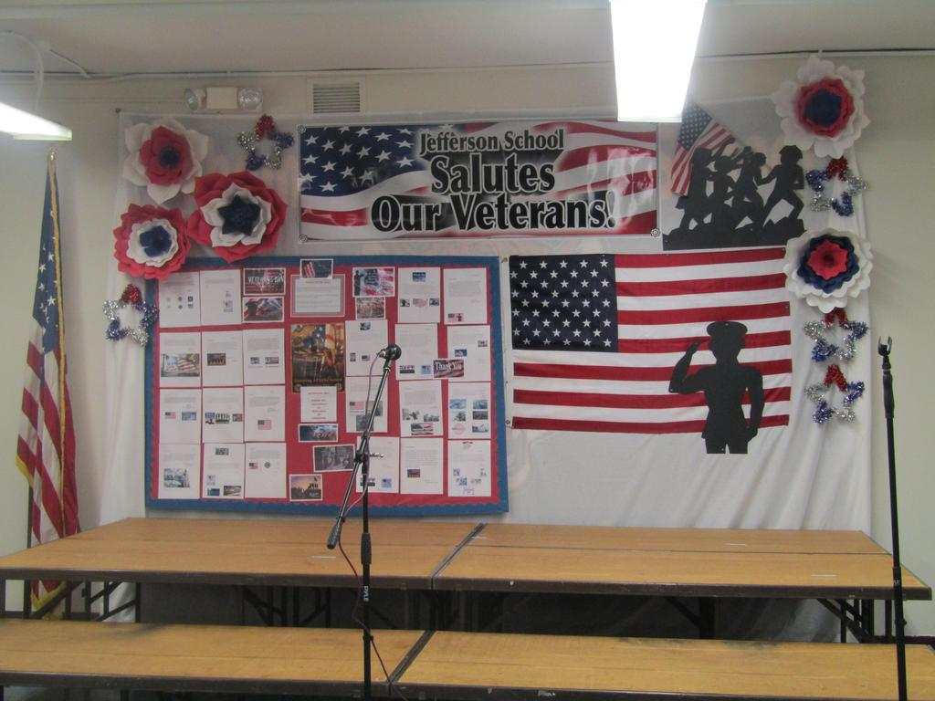 salute our veterans student work display behind the stage