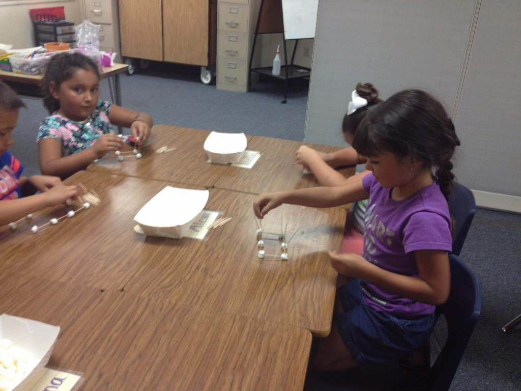 children building 3d shapes with marshmellows and toothpicks
