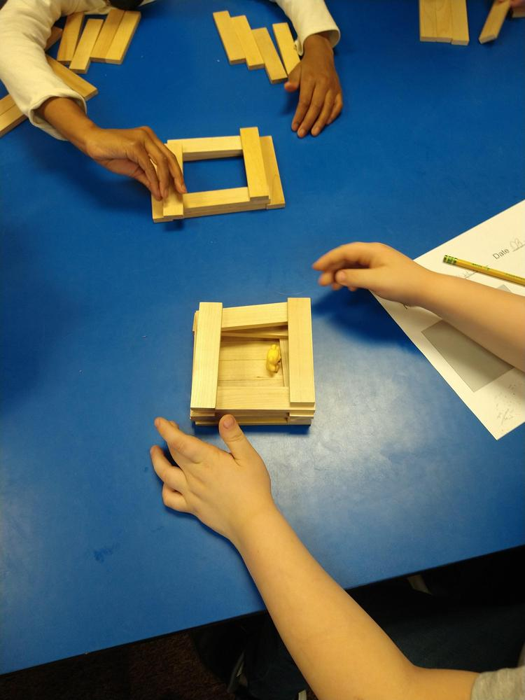 young hands building with Keva planks