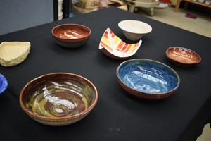 table holding clay bowls