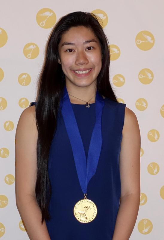 Photo of Morgan Eng wearing Gold Medal.