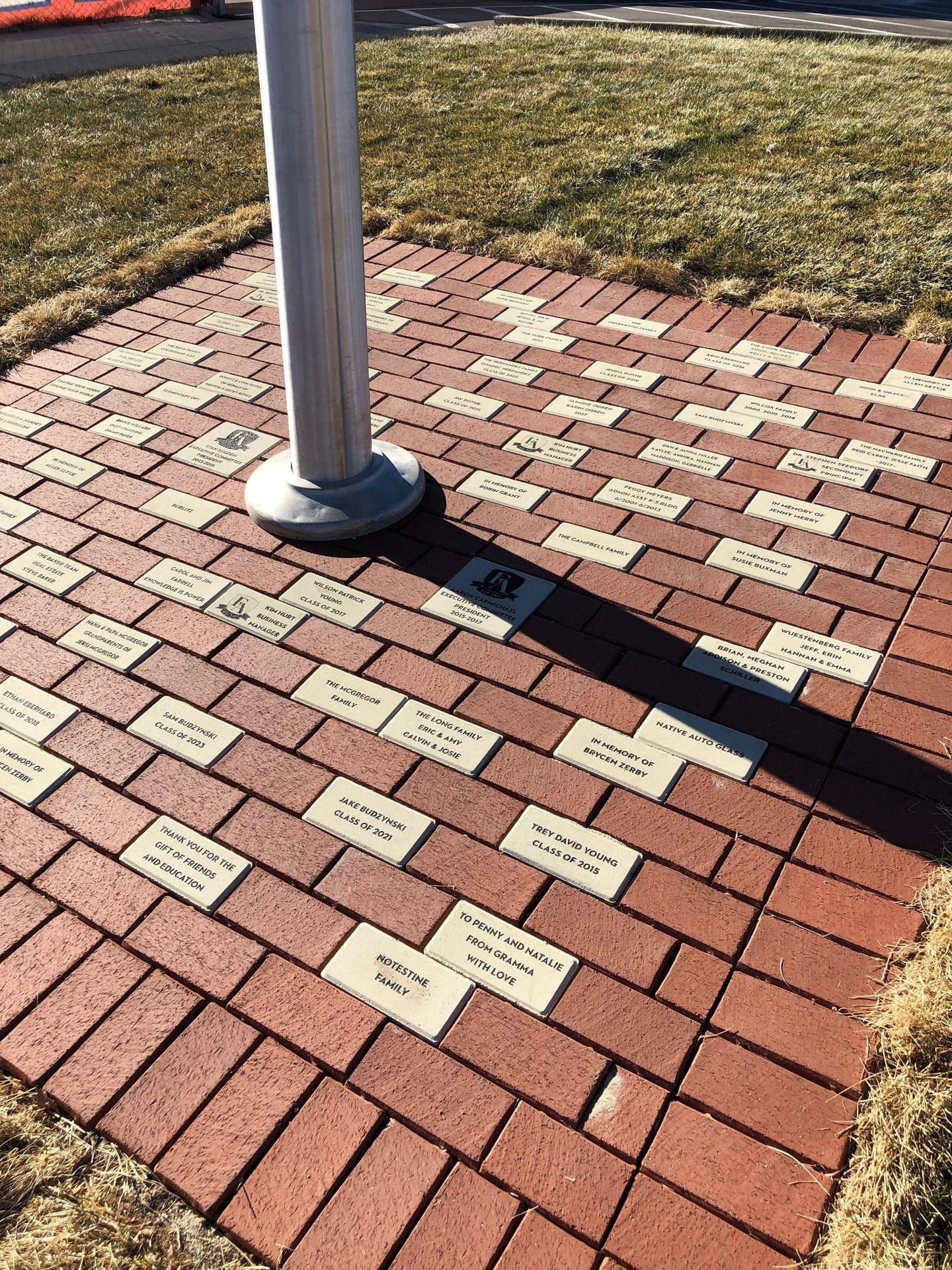 Brick pavers under flag pole.