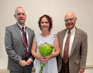 Dr. Jason Conway, Executive Director; Ms. Cindy Davis, Classroom Assistant; and Mr. Paul Scheinert, President-WIU Board of Directors