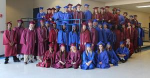 Spring adult education grads pose after ceremony