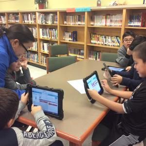 students coding in library.