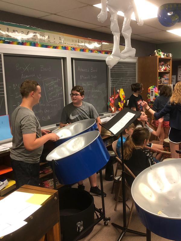 Students demonstrate drumming