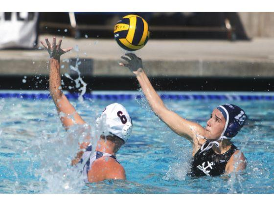 Women's Waterpolo CIF game, player shooting