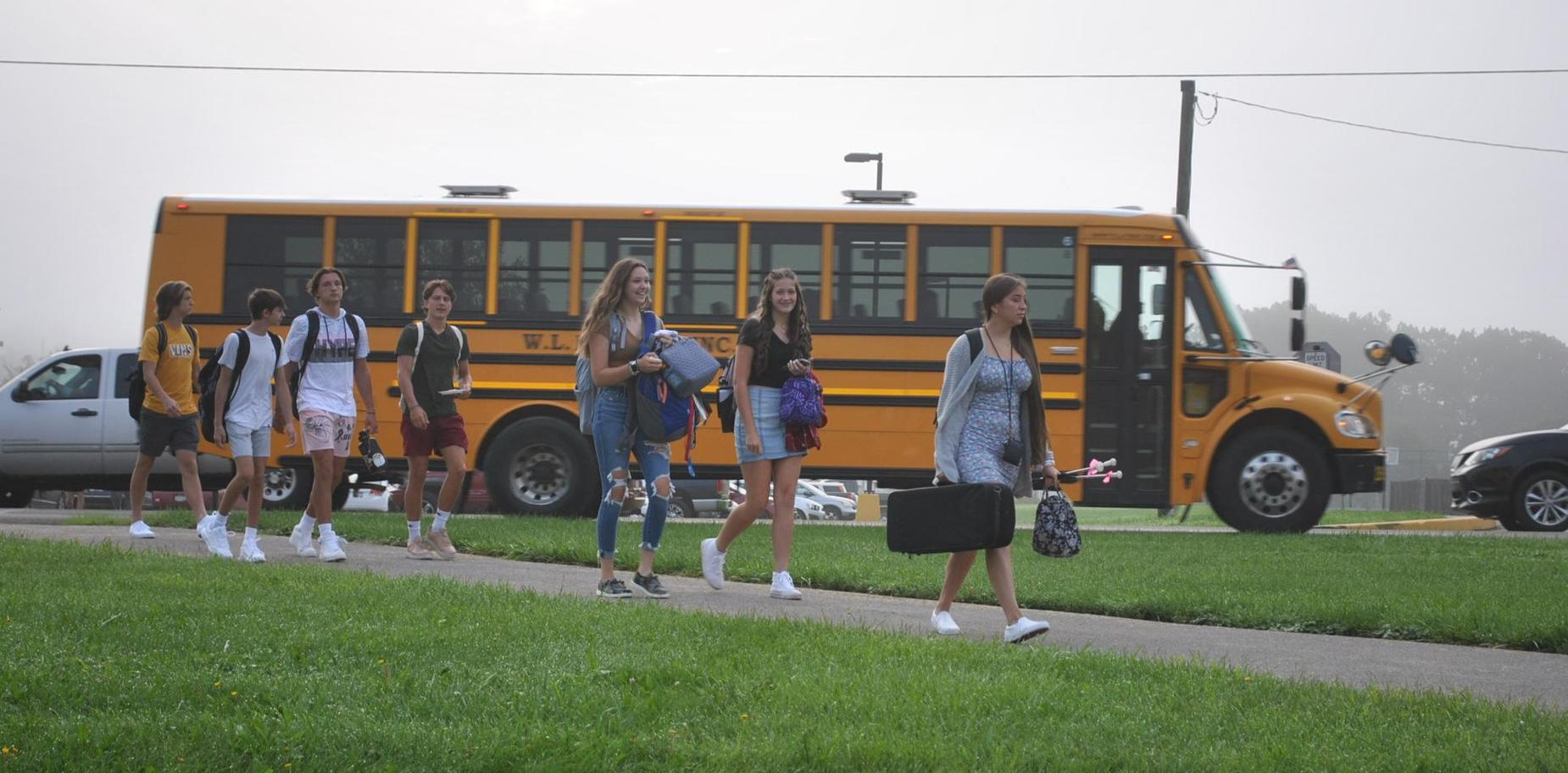Students arriving for school on the first day
