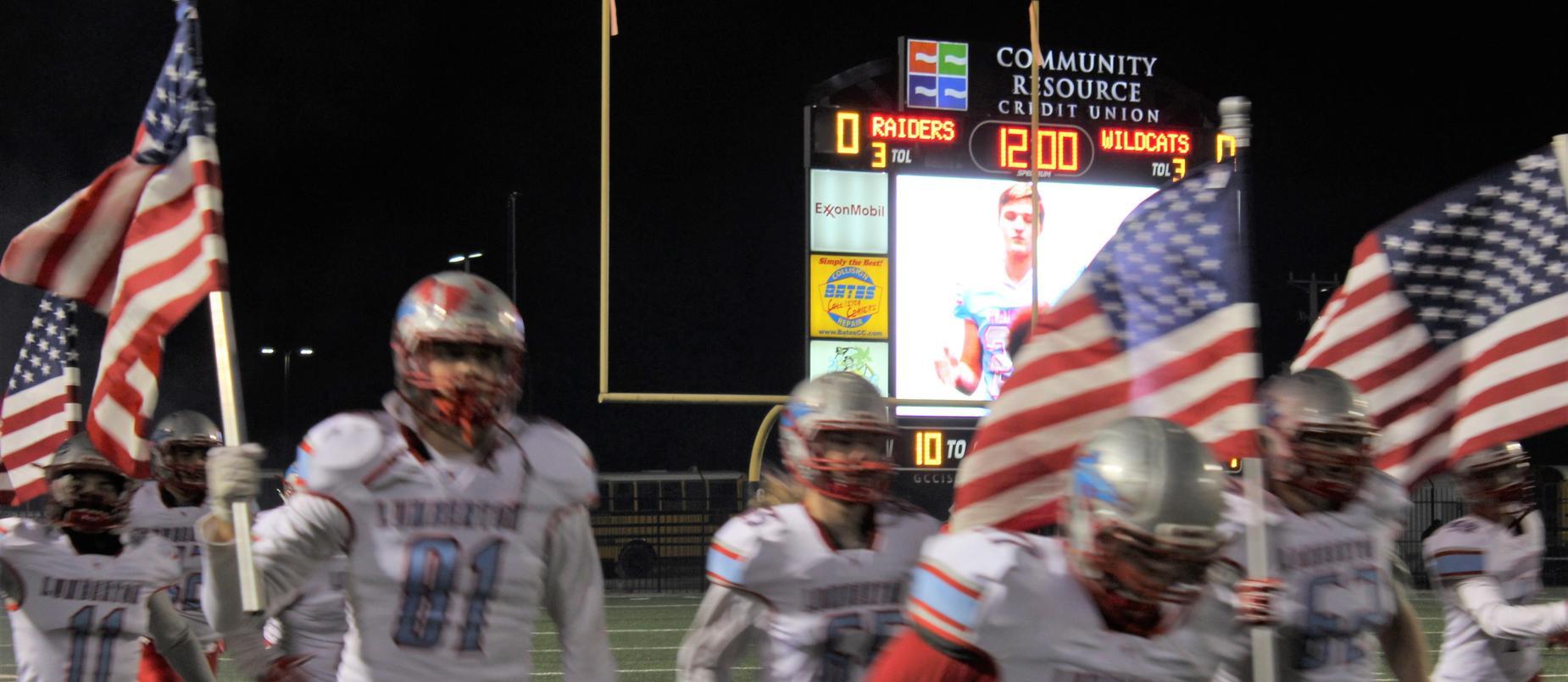 LHS Football Run through with flags