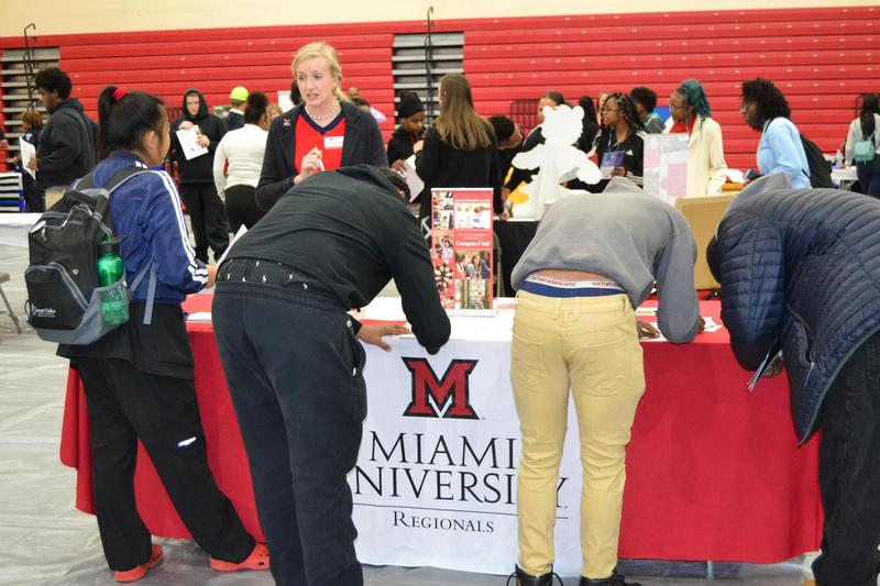 students checking out colleges