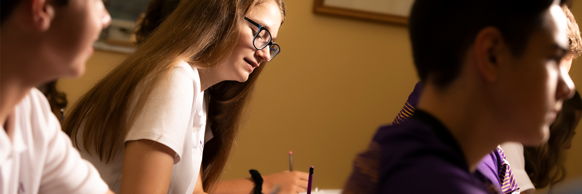 photo of a student working at a desk