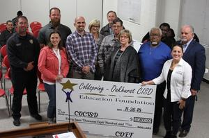 COEF Board presents check to COCISD Board