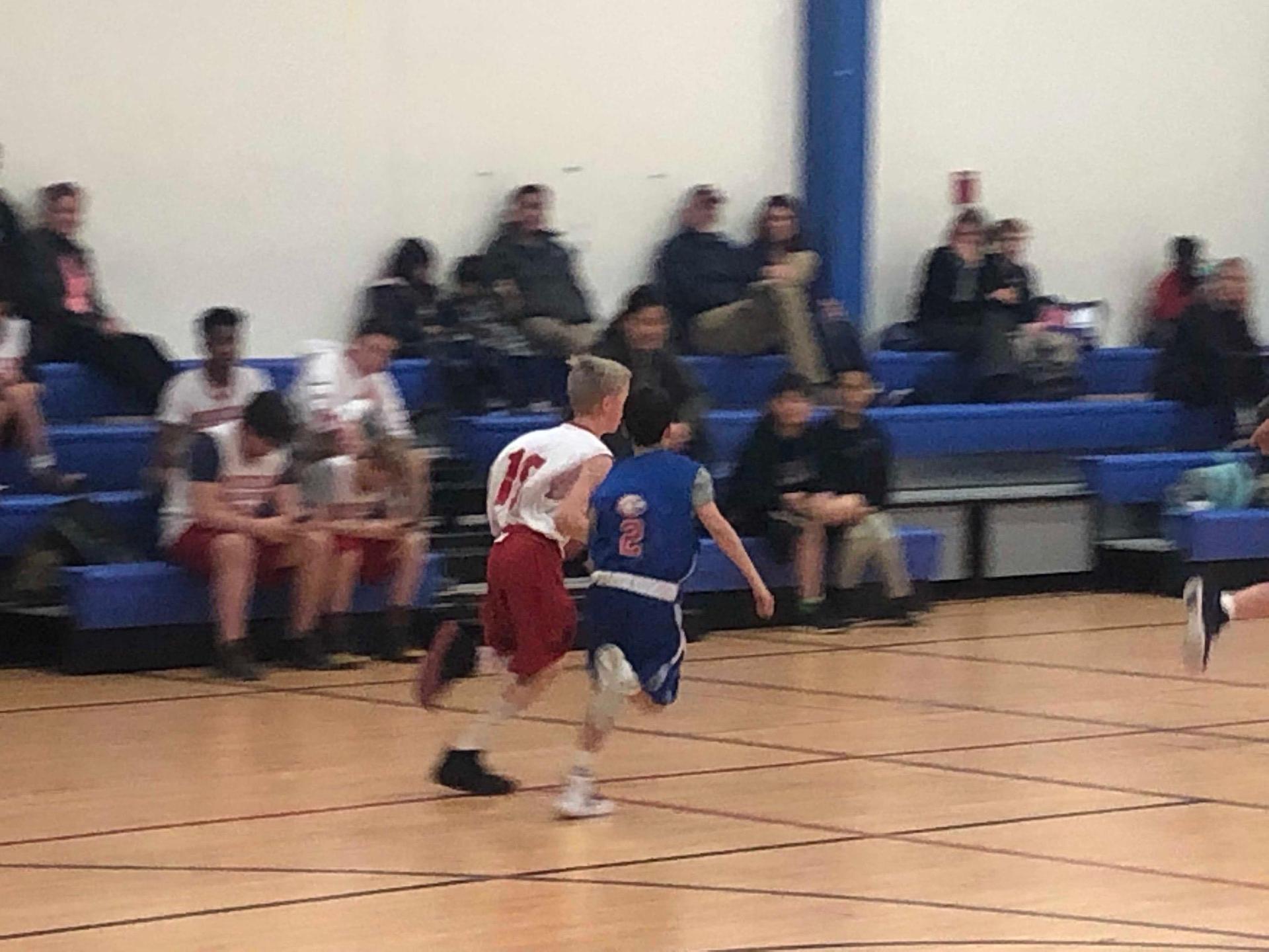 Boys Basketball dribbling down court