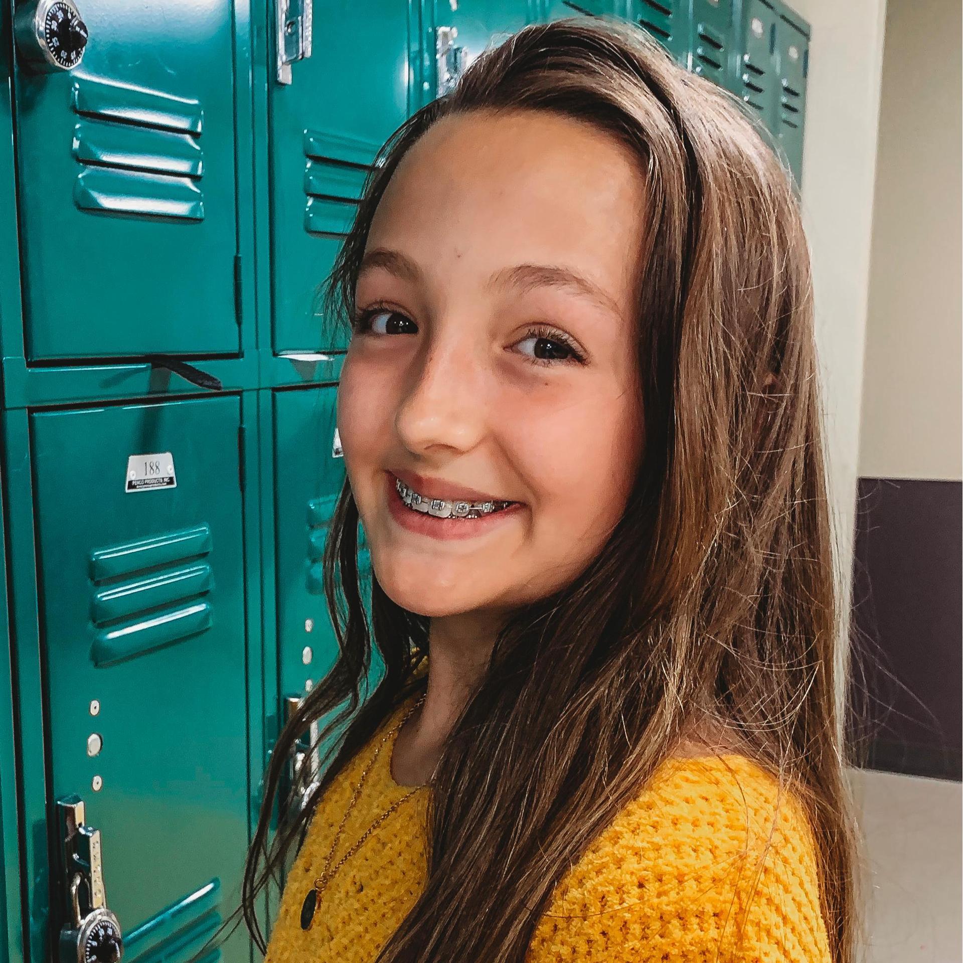 student at locker