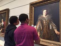 Two children viewing artwork