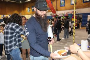 Man getting served food at Cultural Unity Fair