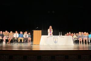 Wide shot of the NHS induction ceremony in the HS auditorium