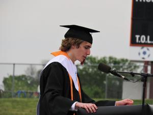 Ben Van Hoven leads the tassel ceremony.