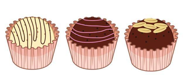 1 white chocolate truffle and 2 dark chocolate truffles in pink wrapping