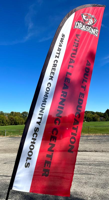Flag displaying Virtual Learning Center and Adult Education