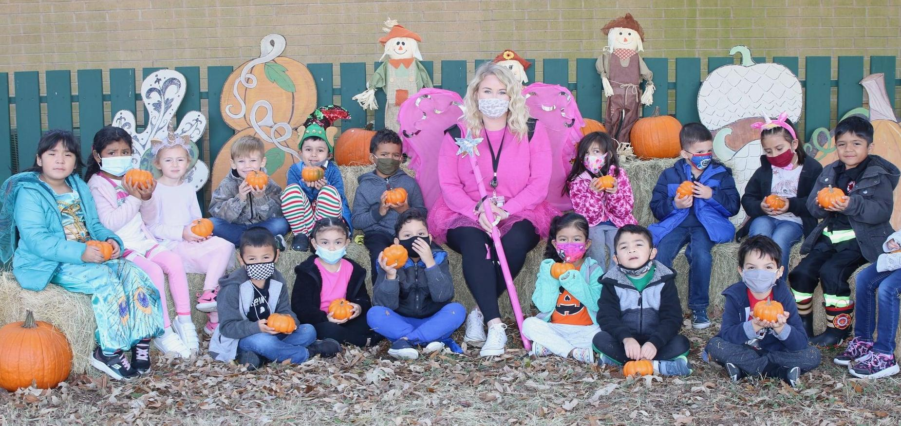 kindergarteners enjoy their mini pumpkins