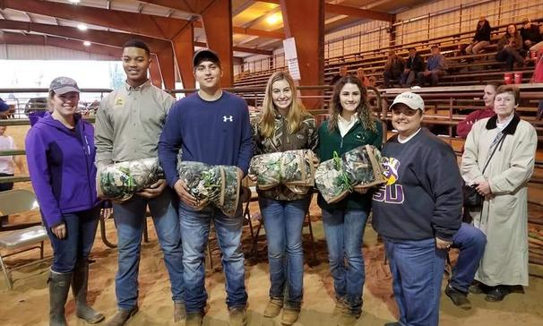 Graduating seniors receive their FFA blankets.