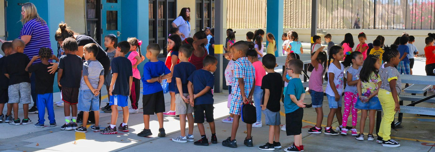 Students waiting in line to enter the classroom