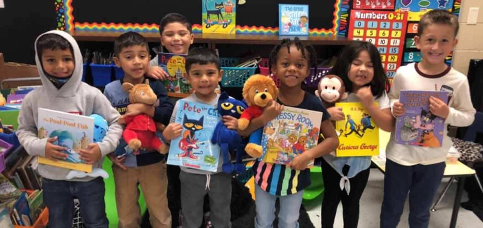 students holding books on storybook character day