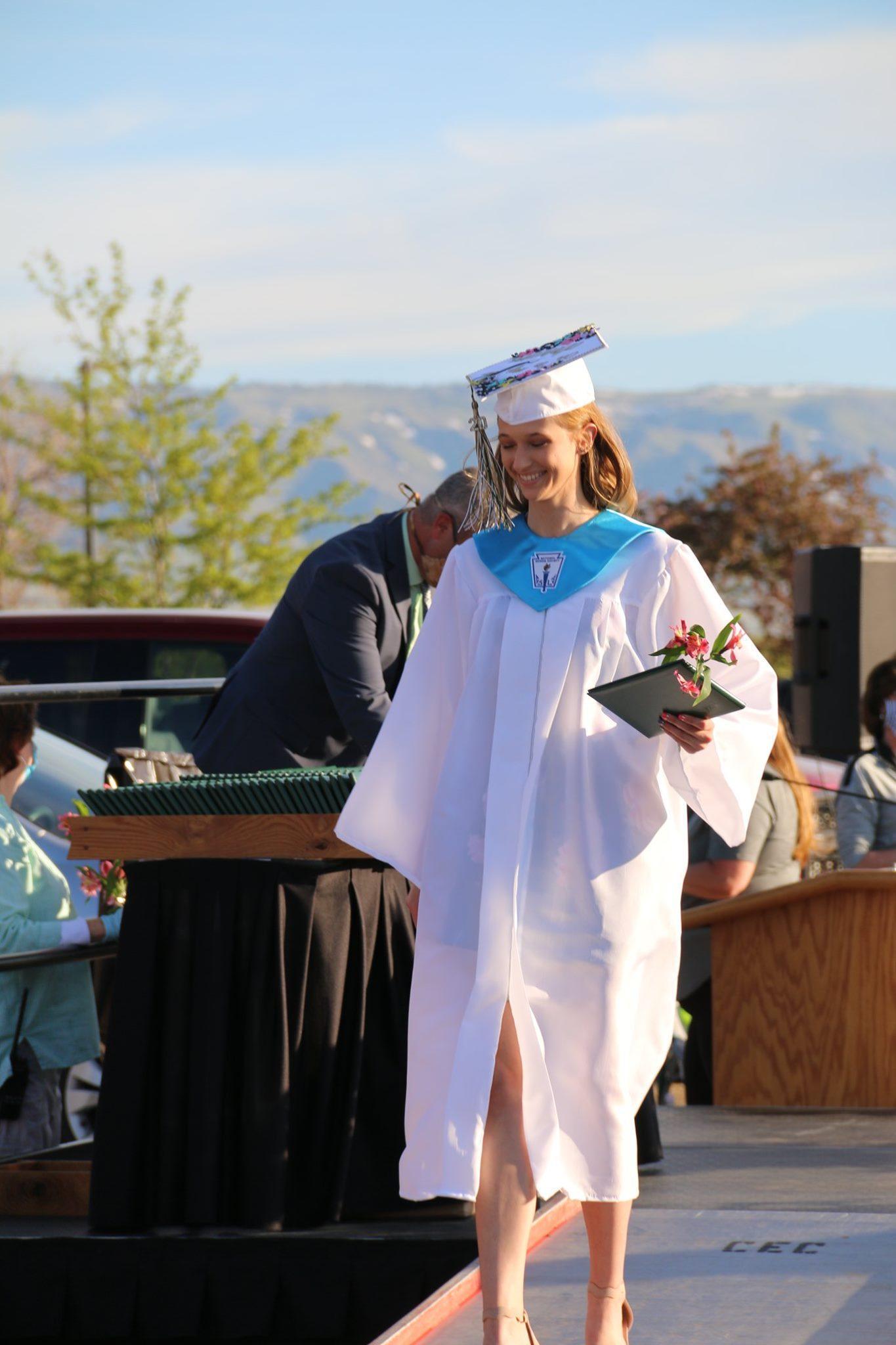 Girl walking at High School Graduation