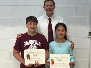 two student principal's award winners with principal