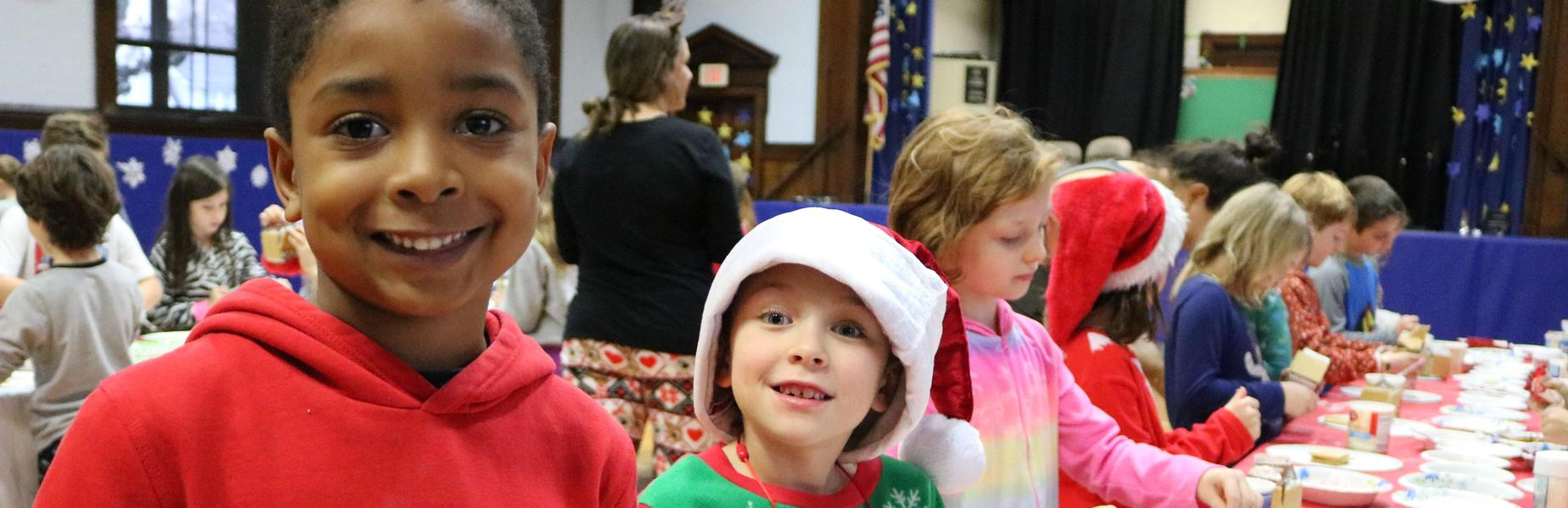 McKinley School 2nd graders make gingerbread houses, one of the many holiday activities taking place around the district.
