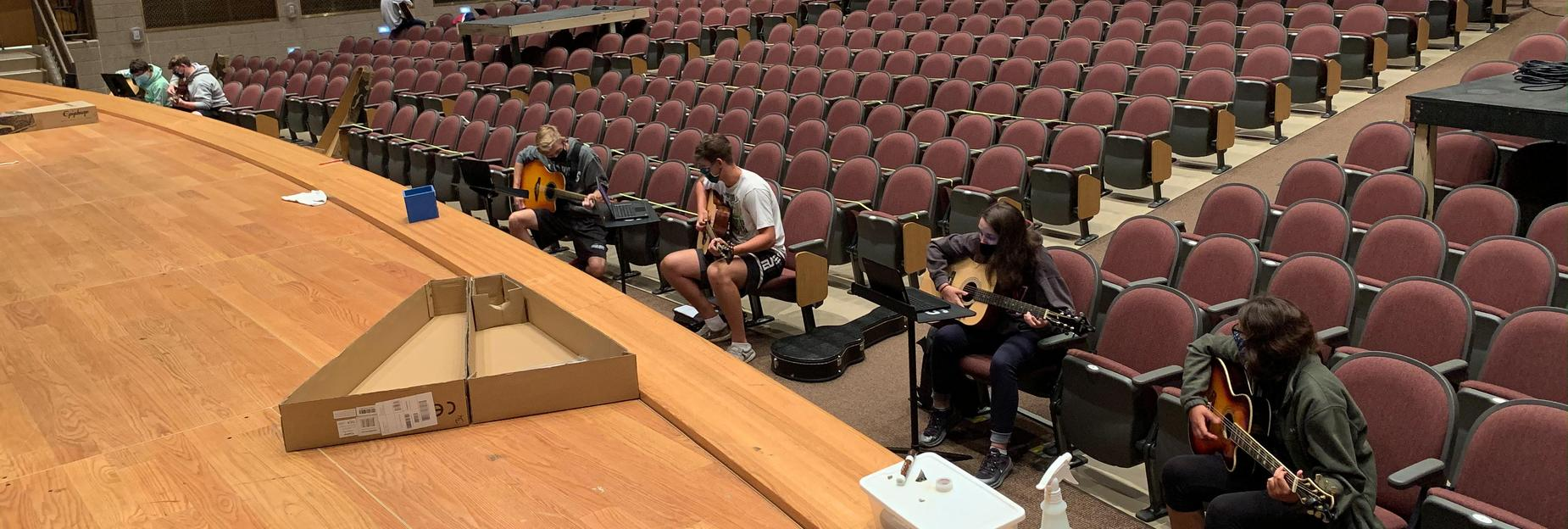 social distancing in the auditorium to learn guitar