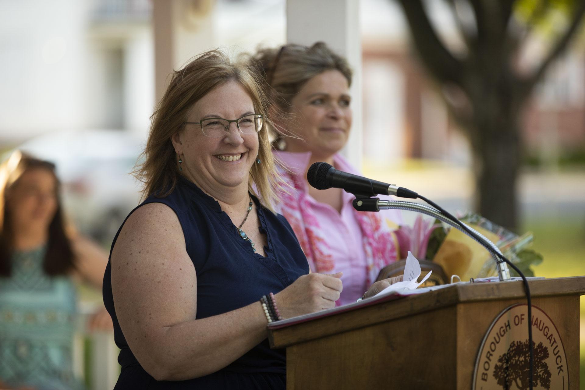 Jill Mahoney smiling at podium