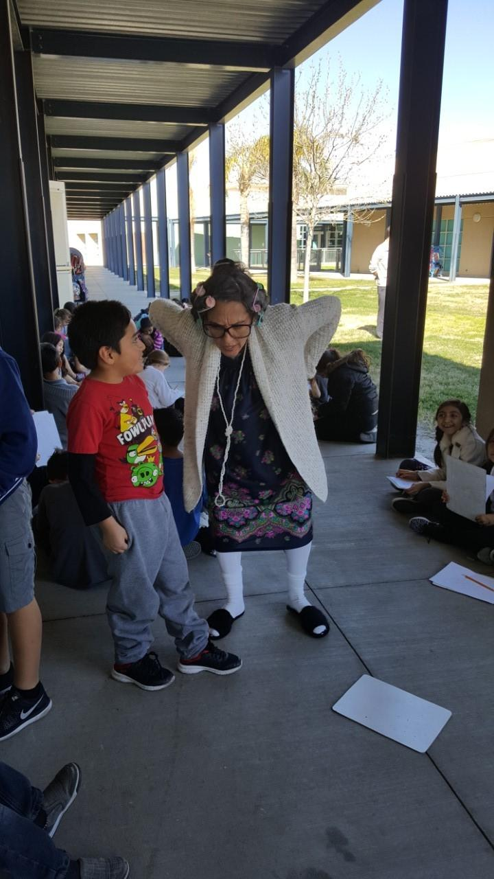 Principal Heeren getting into costume!