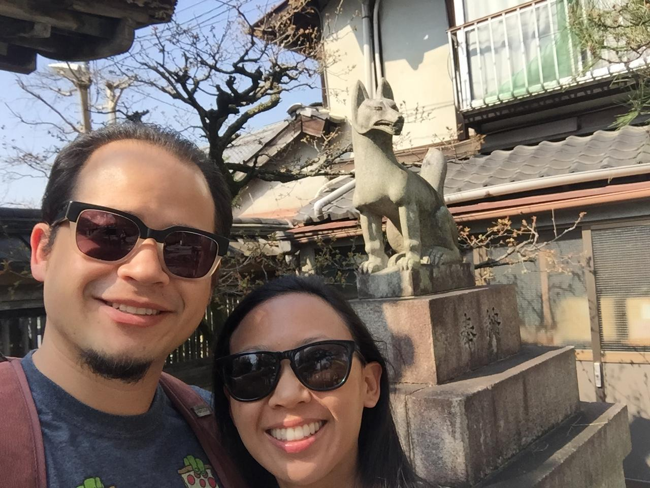 A picture of Mrs. and Mr. Palmer posing in front of a Shinto Shrine in Kyoto, Japan