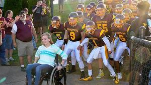 Searra Inman and brandywine bobcat football team before friday night game