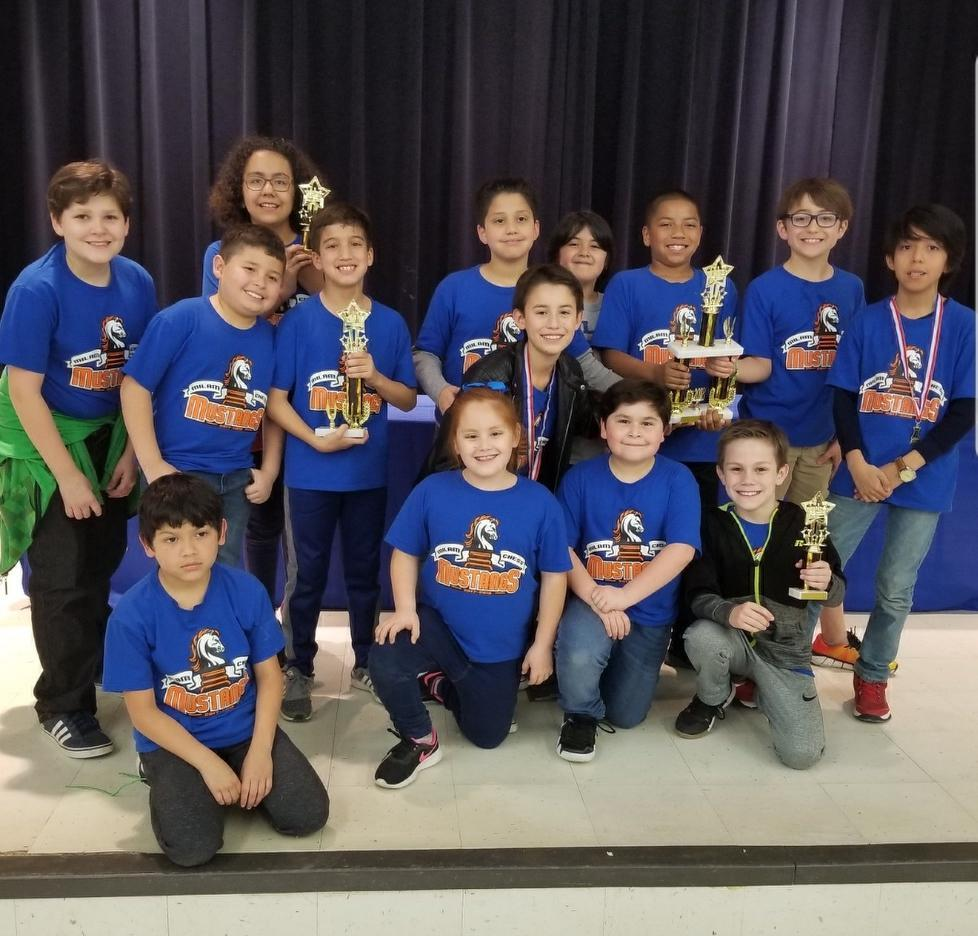 Chess team with trophies.