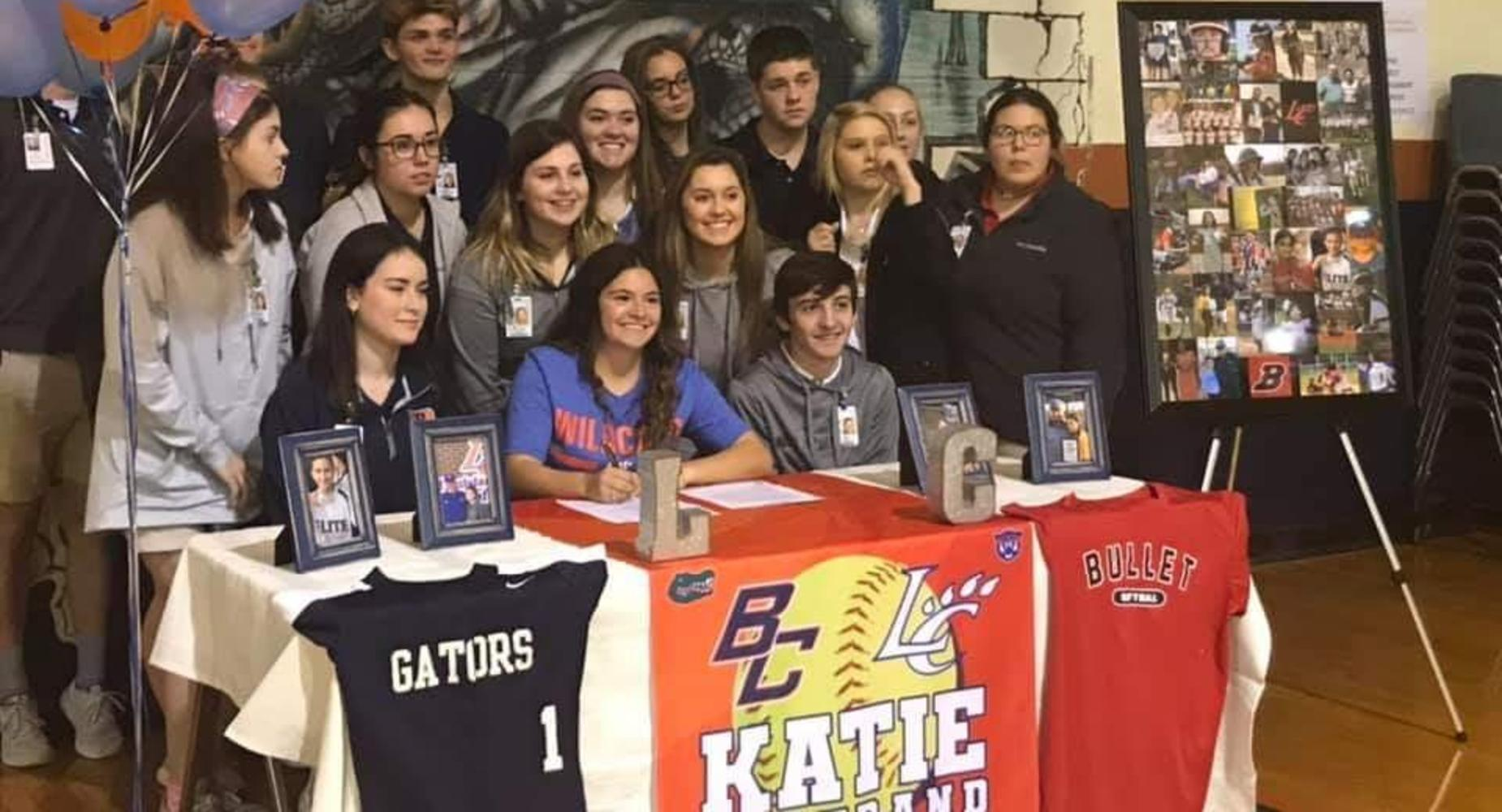 Katie Bertrand sign a contract for with Louisiana College for Softball.