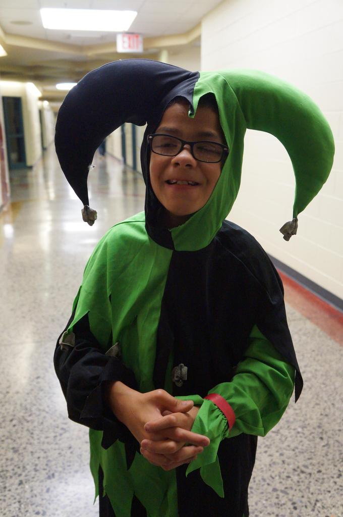 Student in jester Halloween costume at Spooktacular event