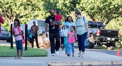 Family Walking into School