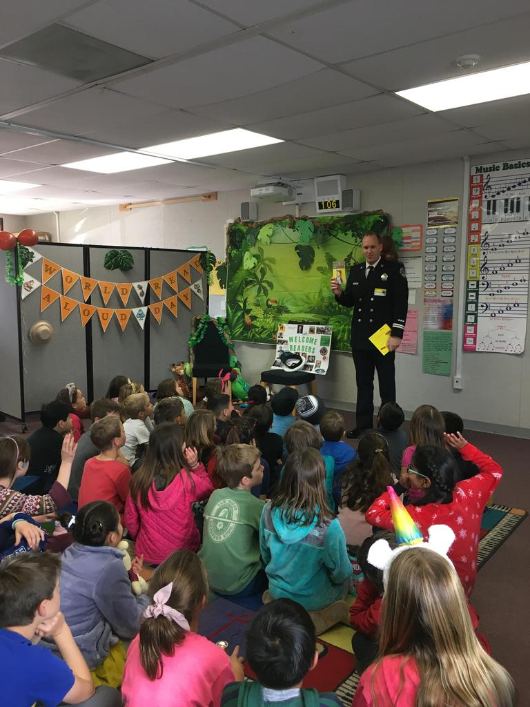 firefighter gets ready to read to students