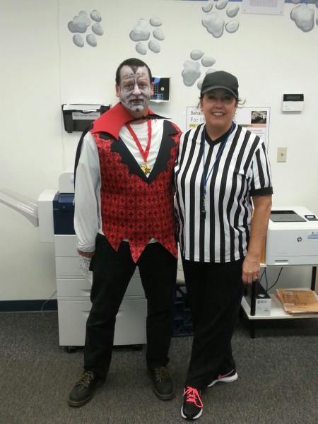 Mr. Brown in costume as Dracula and Principal Mrs. Robilotta dressed as referee