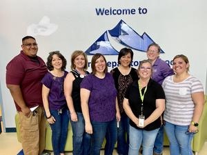 NM Mutual employees pictured after delivering 6 car loads of supplies.