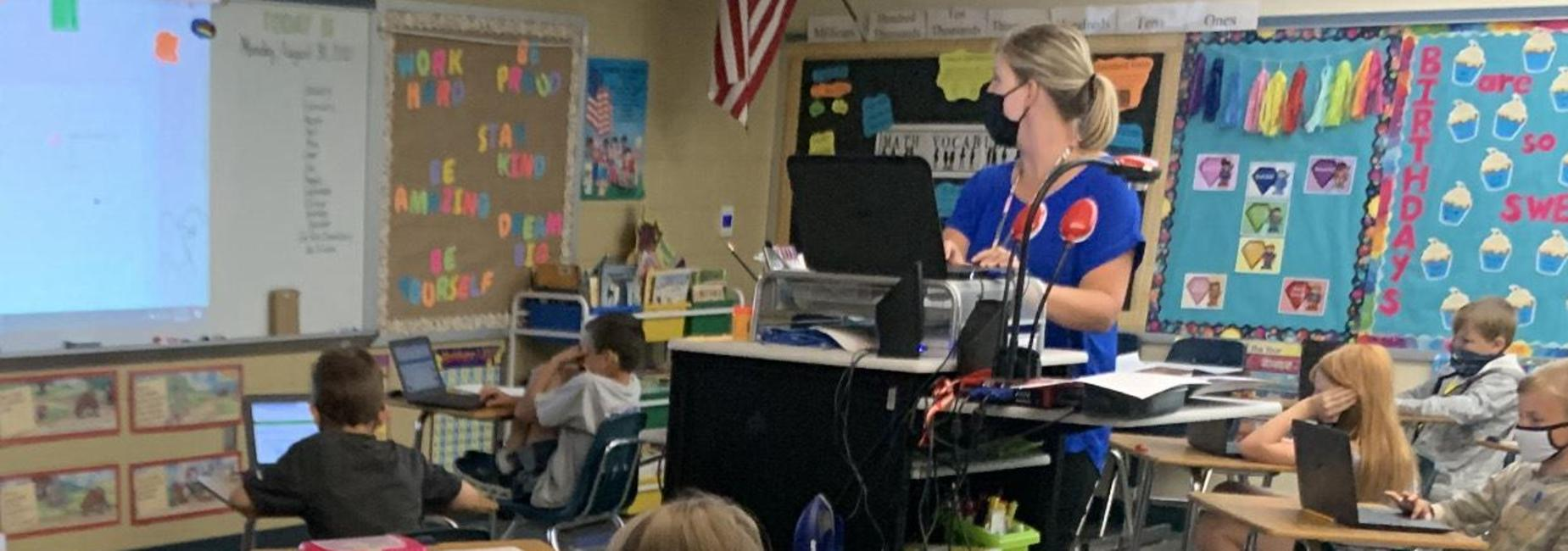 photo of Mrs. Trivette and her class using technology