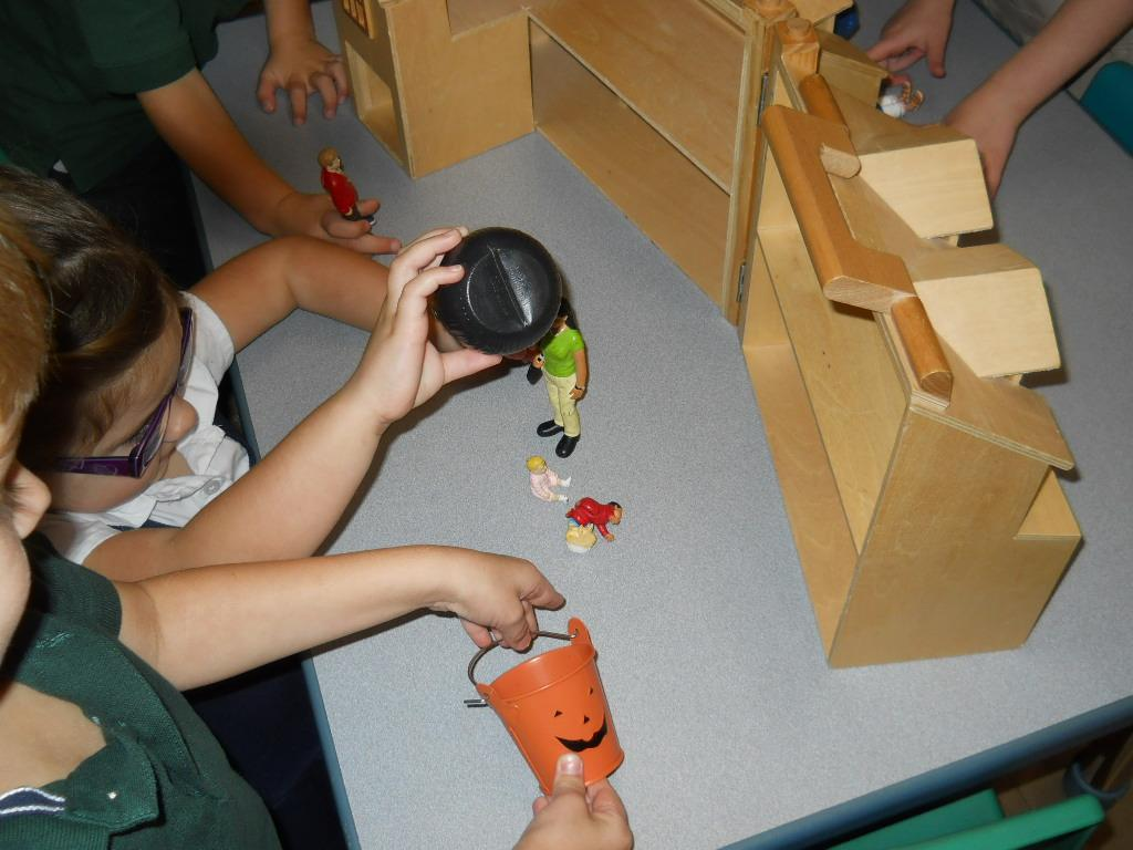 PreK students working at table toys